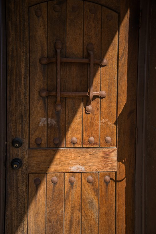 I was fascinated by this old wooden door. It just begged to be photographed. Unfortunately, someone had at some point taped a sign to it and the tape residue persists.