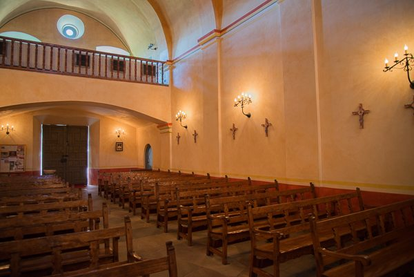 The inside of the mission chapel remains a place of worship.