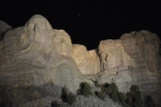 Mt Rushmore at night with lights.